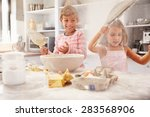 Two Children Having Fun Baking...