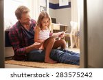 father and young daughter... | Shutterstock . vector #283575242