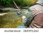Fisherman With Fly Fishing On...
