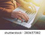 hands with laptop typing in... | Shutterstock . vector #283657382