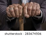 hand of a old man holding a cane | Shutterstock . vector #283674506