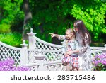 happy mother and adorable girl... | Shutterstock . vector #283715486