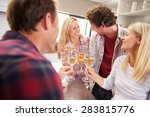 four friends celebrating at home | Shutterstock . vector #283815776