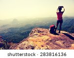 woman hiker taking photo with... | Shutterstock . vector #283816136