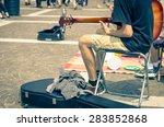 Street Artist Plays Guitar  ...