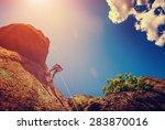 rock climber on a cliff against ... | Shutterstock . vector #283870016