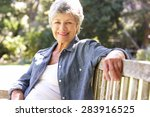 senior woman relaxing on park... | Shutterstock . vector #283916525