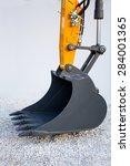 excavator bucket on rubble | Shutterstock . vector #284001365
