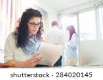 businesswoman reading notepad... | Shutterstock . vector #284020145