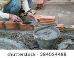 the worker make the brick wall | Shutterstock . vector #284034488