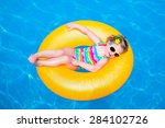 Child In Swimming Pool. Little...