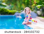 Kids In Swimming Pool. Childre...