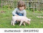 white piglet in girls hands... | Shutterstock . vector #284109542