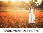Girl Taking Picture On Poppy...