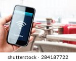 hand holding smartphone with wi ... | Shutterstock . vector #284187722