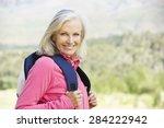 Portrait Of Senior Woman On Hike