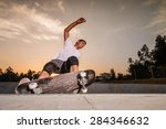 Skateboarder In A Concrete Poo...
