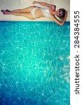 beautiful young woman relaxing... | Shutterstock . vector #284384555
