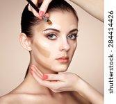 makeup artist applies skintone. ... | Shutterstock . vector #284414426