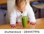 A Cute Little Girl Drinking...