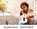 A Street Musician Playing His...