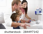 family in bathroom brushing... | Shutterstock . vector #284497142