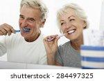 Senior Couple In Bathroom...