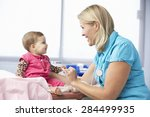 doctor in surgery examining... | Shutterstock . vector #284499935