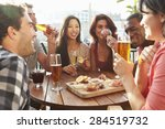 group of friends enjoying drink ... | Shutterstock . vector #284519732
