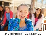 group of children hanging out...   Shutterstock . vector #284520422