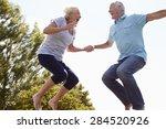 senior couple bouncing on... | Shutterstock . vector #284520926