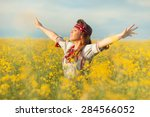 in the field of yellow flowers... | Shutterstock . vector #284566052