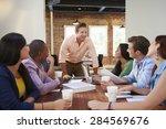 male boss addressing office... | Shutterstock . vector #284569676