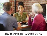 Small photo of Senior Couple Meeting With Financial Advisor In Office
