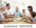 multi generation family eating... | Shutterstock . vector #284570258