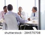 four businessmen having meeting ...   Shutterstock . vector #284570708