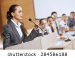businesswoman standing on stage ... | Shutterstock . vector #284586188