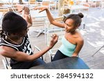 african man sitting with... | Shutterstock . vector #284594132