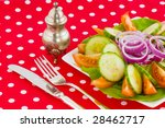 fresh vegetable salad at a red... | Shutterstock . vector #28462717