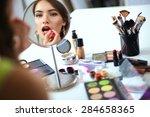 young beautiful woman making... | Shutterstock . vector #284658365