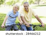 father and son cycling through... | Shutterstock . vector #28466212