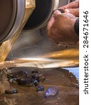 Small photo of Lapidary worker polishing boulder opal gems.