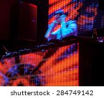 dj mixes the track in motion at ... | Shutterstock . vector #284749142