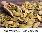 heap of pumpkin seeds with... | Shutterstock . vector #284750945