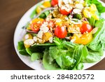 orange spinach salad on the... | Shutterstock . vector #284820572