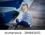 a cute little girl in a striped ... | Shutterstock . vector #284842652