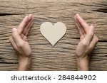 Woman Hand With Paper Heart On...