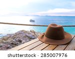 hat on the table at the beach... | Shutterstock . vector #285007976