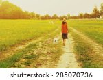 Stock photo girl walking with her puppy 285070736
