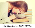 tired woman slepping on books. | Shutterstock . vector #285127736